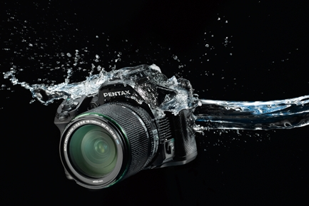 Pentax K30 is splash proof but not for underwater :)